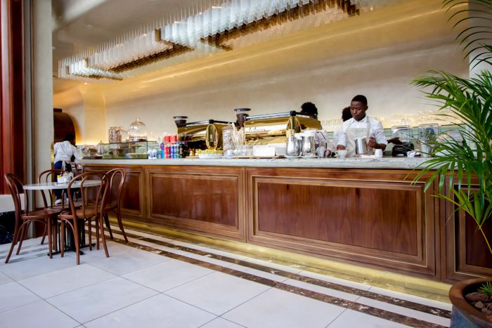 We love this bar!  Timber, brass edging and Rudi's Choice granite countertops make for an impressive restaurant interior.  Tashas eatery Canal Walk Cape Town. Get your granite and marble slabs from www.rudischoice.co.za in South Africa and Zimbabwe
