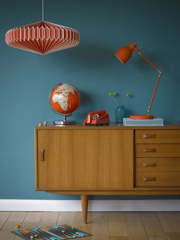 Sideboard style.  Goldfish Orange Lampshade, Globe Light and Task Lamp by Wild Wood. Goldfish Orange Trim Phone by Wild & Wolf. Backgammon Board by Ridley's Games Room.