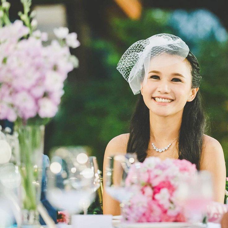 Gorgeous Guy wearing her custom Amahle Birdcage veil on her wedding day!