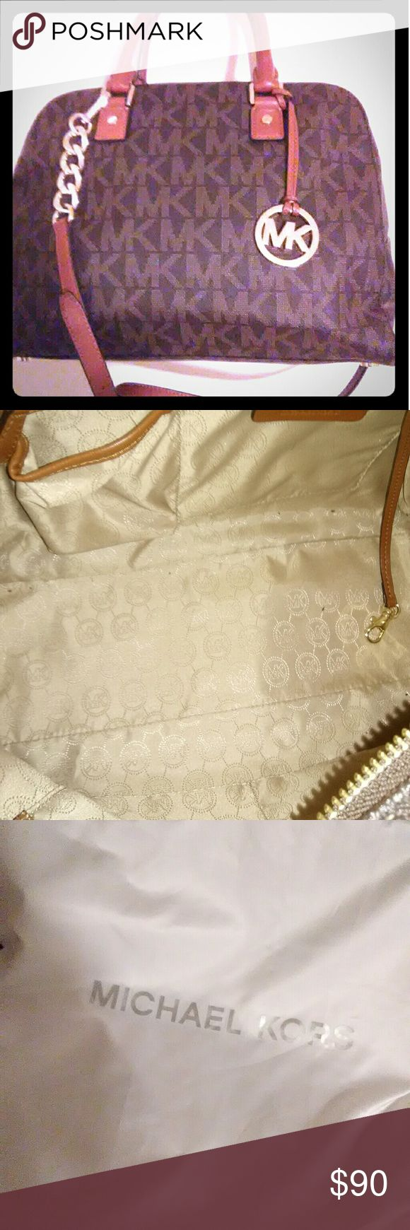 """Michael Kors handbag Authentic!! Used only a few times. Dust bag and tags included. No stains, tears or flaws except for a slight musty smell that is a mystery to me as it has never been damp or wet and stored in same location as my other stored bags. None of them have that issue. Approximately 13.5"""" long, 10"""" tall, 6"""" wide. Cross listed. Michael Kors Bags"""