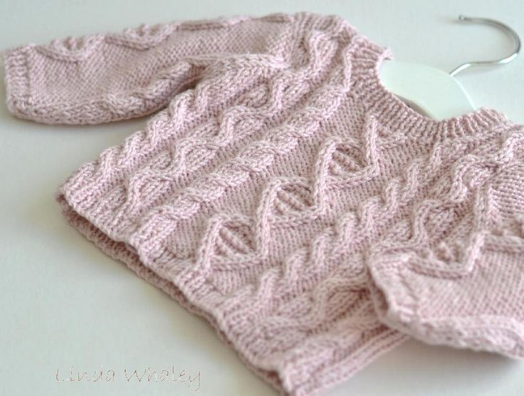 Rocket Clothing London by Linda Whaley. Knit this classic cabled baby sweater in any DK yarn. The sweaters here are knitted in Rowan Wool Cotton and 100% Cotton. Thiscabled crew has a button-through opening across one shoulder for easy dressing. To ensure this pattern is very easy to read, each size has beenwritten individually and includesa combination of written and charted instructions. As this detailed pattern is longer than standard patterns just select and print pages for the…