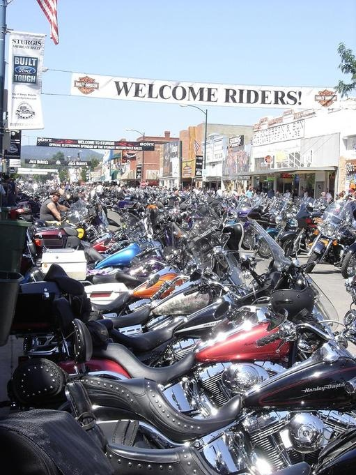 Sturgis, SD, bike week. Our shop is on the right hand side, directly below the Harley sign on the banner. You can just make out someone standing in our window, checking out some jewelry! My all time favorite job!