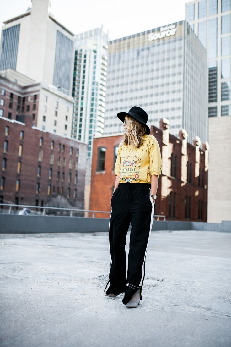 wide brim black hat vintage yellow baseball tee striped who what wear track pant grey suede ankle boots / ragpepper.com / catherine truman photography