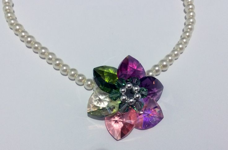 Swarovski pearls and crystals necklace with flower pendant You can order at delizejewelry@yahoo.com