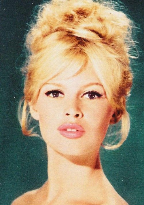 Brigitte Bardot. Winged eye liner, bronzer, a pale pink lip, and a messy up do.