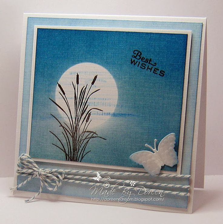 """By Doreen. Mask the moon on linen cardstock. Sponge/dust from darker at the top (Distress ink faded jeans) to lighter at the bottom (Distress ink salty ocean) -- This is called the Ombre Technique. The stamp is """"Bullrush"""" from Inkylicious."""