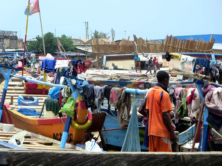 The fishing boats and markets around the Benya Lagoon at Elmina, Ghana, present a colorful scene.