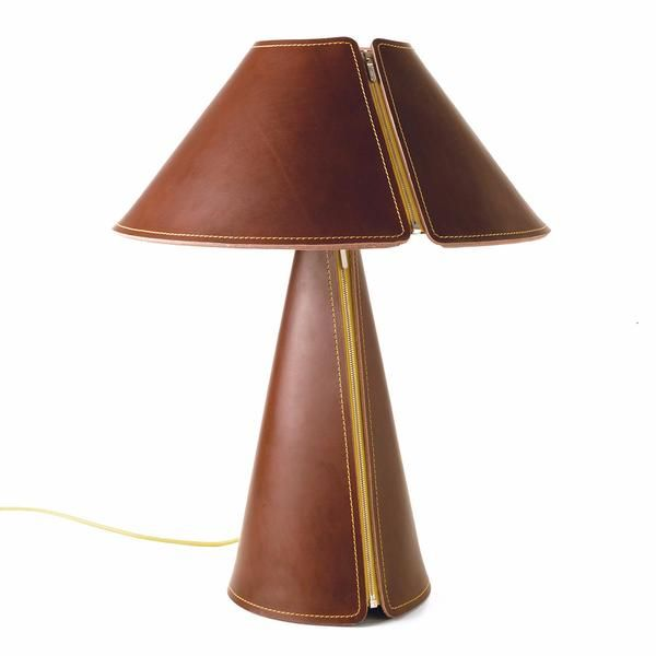 In El Senor, German lighting studio Formagenda have streamlined the classic form of a table lamp in sumptuous leather with contrast stitching and zipper detail.