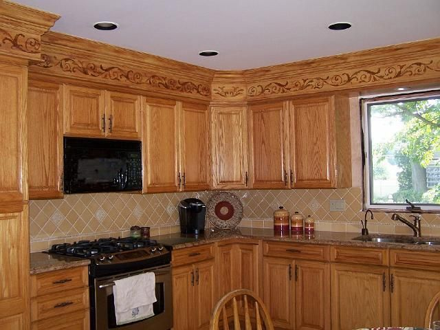 A faux oak grained finish with an inlaid design - that disguises a kitchen soffit.  Click on the pic for how I did it