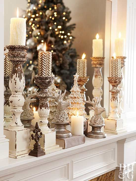 All is bright with this Christmas fireplace decor. Salvaged candle holders light the way to a vintage-inspired mantel. Reindeer and Christmas tree figurines embedded among the candles add extra holiday cheer.
