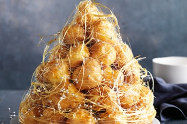 """Croque-en-Bouche.  A traditional French wedding """"cake""""also popular with French-Canadians.  I had amazing results making this with pre-made frozen cream puffs but following the rest of the recipe.  A show stopper for the holidays and special Ocassions."""