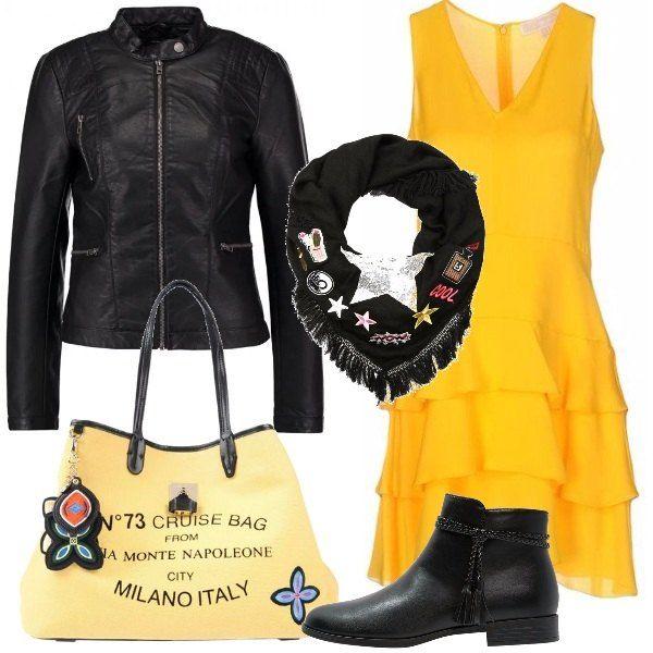 Outfit adatto per un pomeriggio primaverile o una serata improvvisata con le amiche. Vestito giallo in crèpe con collo a V, giacca in finta pelle nera con collo alla coreana, tronchetti neri bassi, borsa a mano in pelle gialla e foulard nero con patches e frange.