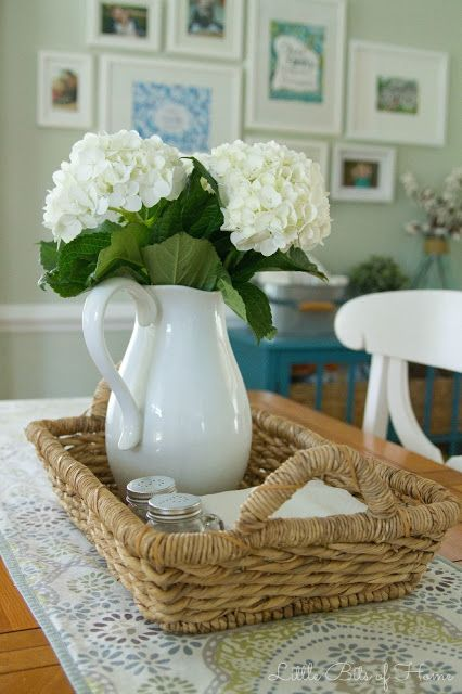Love the simple and functional centerpiece: table runner, with tray that contains vase+flowers, salt and pepper, and napkin. Very functional and when need to be moved, just need to move the tray away.