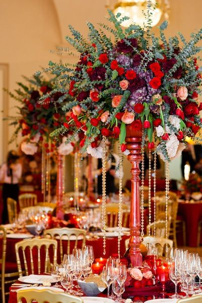 Red wedding centerpieces with roses and crystals