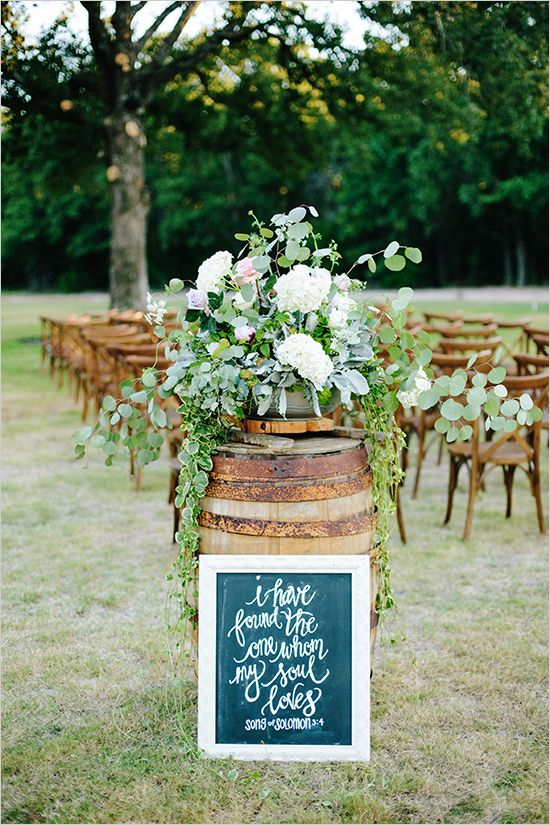 #weddingaisle decor idea: whiskey barrel decor. perfect for a #rustic wedding see more http://static.weddingchicks.com/2015/09/08/white-and-purple-glam-farm-wedding/