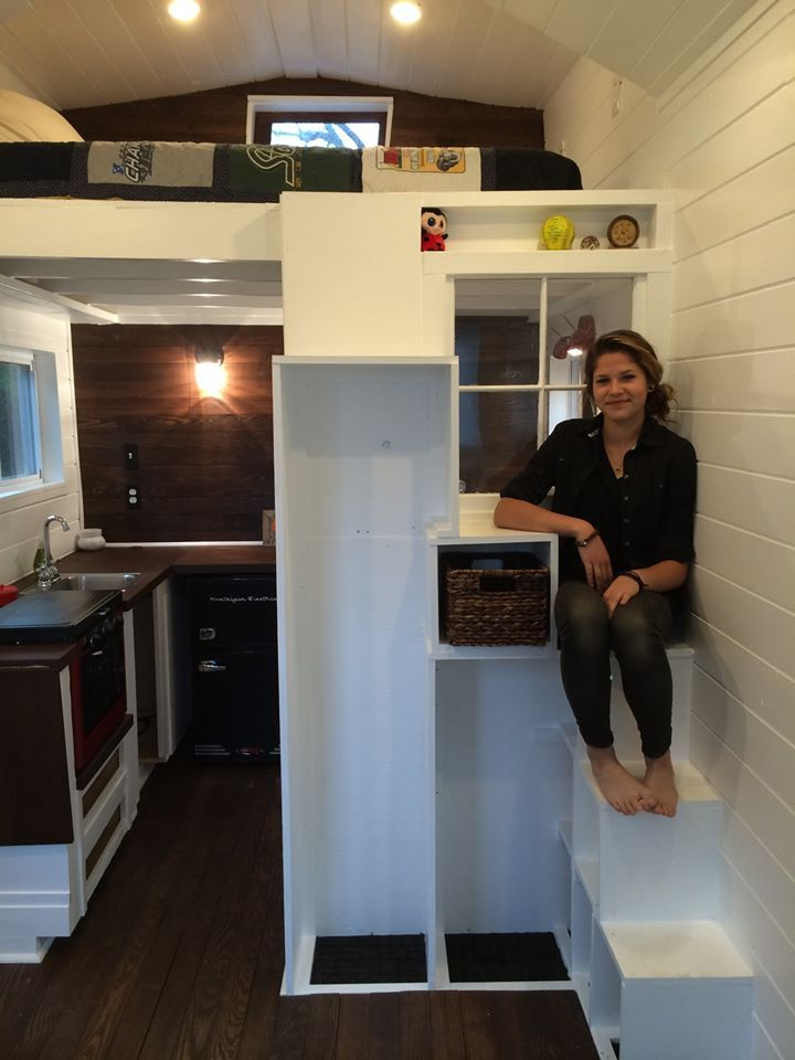 I love that this tiny house has 'stairs' to the loft that double as storage instead of the typical ladder.