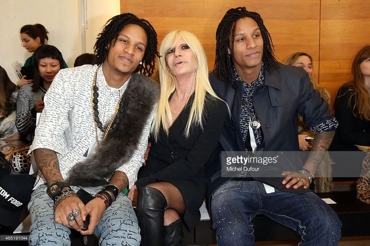 Larry Bourgeois, Laurent Bourgeois 'Les Twins' and Donatella Versace (C) attend the Anthony Vaccarello show as part of the Paris Fashion Week Womenswear Fall/Winter 2015/2016 on March 3, 2015 in Paris, France.