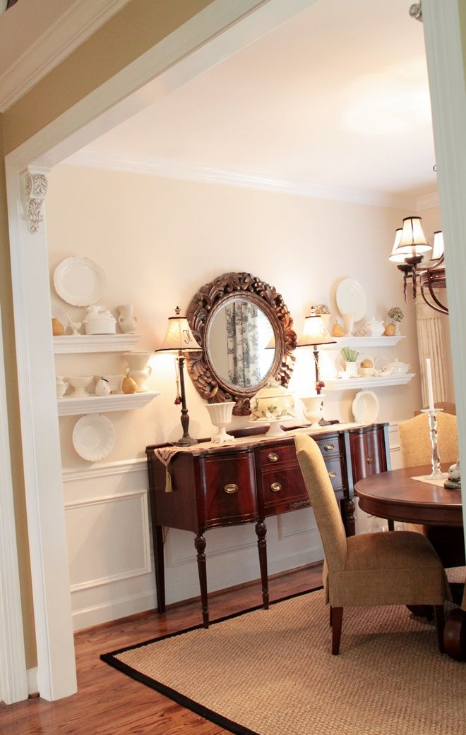 love the white shelves & mirror above the buffet