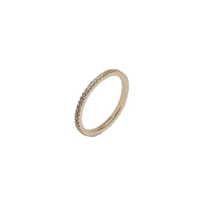 A chic 18K yellow gold band composed of sparkling brilliant cut diamonds, the Carina Yellow gold ring is inspired by the stars that shine bright like diamonds in the sky.