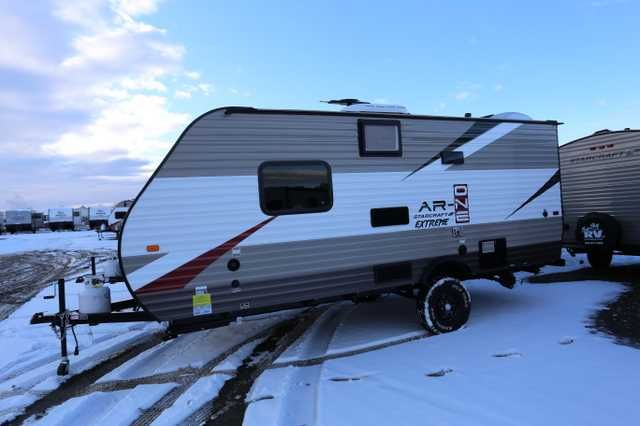 "2016 New Starcraft Ar-one 18 QB Travel Trailer in Montana MT.Recreational Vehicle, rv, 2016 Starcraft Ar-one 18 QB, 2016 Starcraft Ar-one 18 QB Travel Trailer, 2016 Starcraft AR-ONE Extreme 18 QB (Queen Bed) travel trailer, Java Interior decor. Front queen bed, side kitchen across from L-shaped sofa/dinette, wardrobe by entry door, rear bath. Extreme Package includes flipped axles and 15"" Off-road mud tires for 5"" of extra ground clearance, enclosed underbelly, total thermal foil wrap for…"