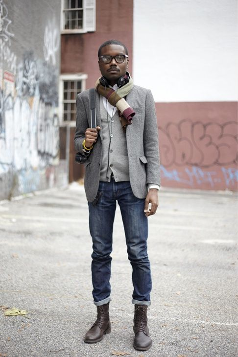 Choose a grey wool blazer and navy jeans if you're going for a neat, stylish look. Finish it off with dark brown leather boots.  Shop this look for $415:  http://lookastic.com/men/looks/boots-jeans-blazer-cardigan-longsleeve-shirt-scarf/4274  — Dark Brown Leather Boots  — Navy Jeans  — Grey Wool Blazer  — Grey Cardigan  — White Longsleeve Shirt  — Brown Horizontal Striped Scarf