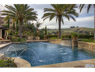 Versante Ter. Chino Hills. 5bdr 6ba 4287 Sq. Ft. 0.46 Acres. Tuscan style, built in 2007. Tuscan Villa located in the exclusive Vellano Country Club. Custom backyard (ground level-no steps), filled w/Olive trees, custom lighting, oversized heated pool, spa for 10, both w/custom glass and Italian tile. Dining room w/custom french doors lead to fully landscaped backyard. Photo 27 of 30Retaining Wall