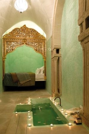 a candlelit bath and a glorious day bed - so private - Riad Dar Sabri, Tunisia by iness