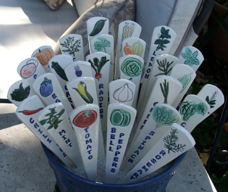 Three Ceramic Garden Markers, Garden Plant Markers,Individually Hand Painted Vegetables and Herbs, Ready to Ship by sumiko2 on Etsy https://www.etsy.com/listing/173249537/three-ceramic-garden-markers-garden