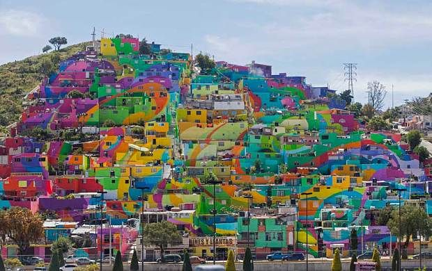 Hundreds of houses painted in bright colors in what organizers claim is Mexico's largest mural, is part of a government-sponsored project is called Pachuca Paints Itself, in the Palmitas neighborhood, in Pachuca, Mexico