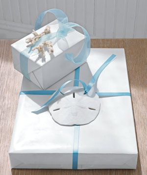 Jazz up your gift wrapping skills for this Mother's Day. Simple additions like a piece of coral or a sand dollar can add a nice touch.