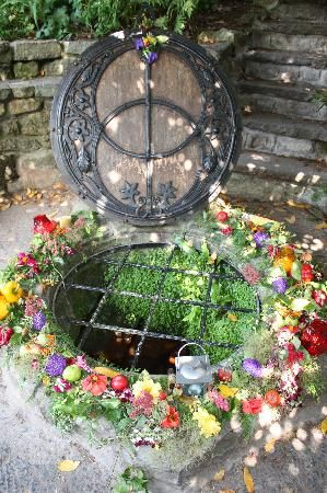 A well dressing ceremony - Chalice Well in Glastonbury, England.