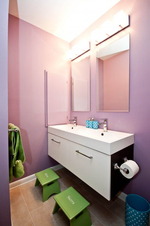 Wall mount vanity with open space between the floor and vanity perfect for tucking away step stools bath toys and cleaning under