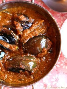 Hyderabadi Bagara Baingan / Stuffed Eggplants in a Nutty Masala Sauce (akshayapaatram) -- a bit of work preparing the pastes, stuffing the eggplants and frying them. Super rich but rewarding on the palate :)