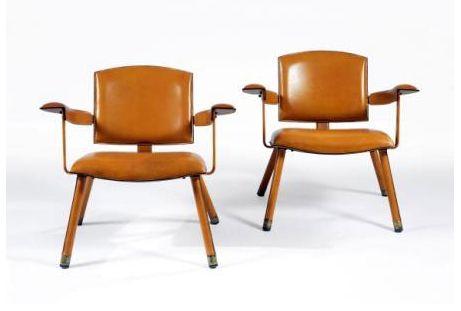 Jacques Adnet, paire de fauteuils 1950's