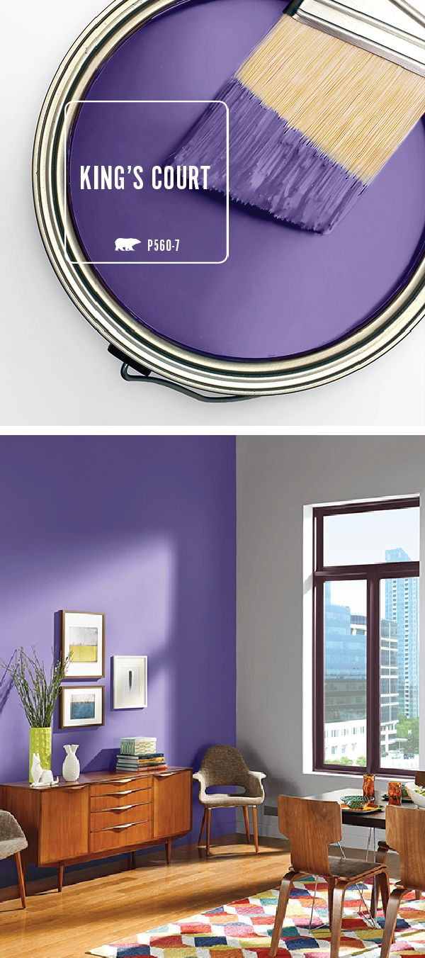 BEHR Paint in King's Court is the bold splash of color that this accent wall needs. The dark purple hue pairs perfectly with the light gray walls and vintage-inspired warm wood furniture in this dining room. Click here for even more design inspiration with the BEHR Paint Color of the Month.
