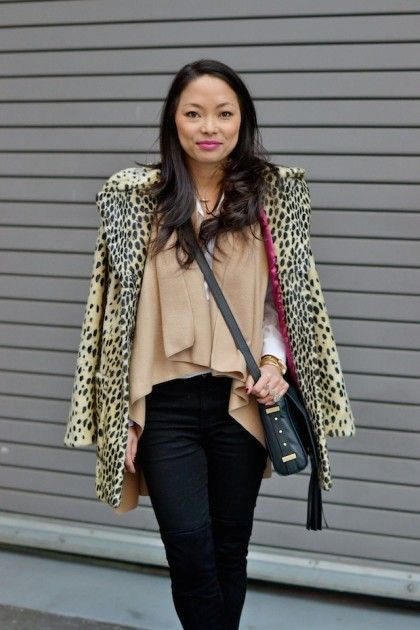 To add warmth without subtracting style, layer a vest underneath your leopoard coat!   theglitterguide.com