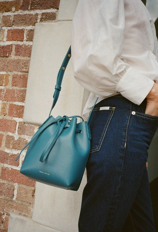 The Mansur Gavriel Mini Mini Bucket Bag in Teal is a small bucket bag with  an adjustable strap. Made of Italian saffiano leather this bag features  gold ...