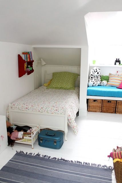 mommo design - 10 ATTIC ROOMS> Love how the head board area is tucked away. Cool reading lamp/nook idea