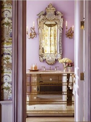 Spectacular lavender bathroom with Venetian mirror & mirrored vanity.