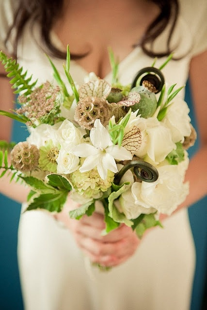 Include rare flower bouquet items such asfern curls, scabosa pods, or silver