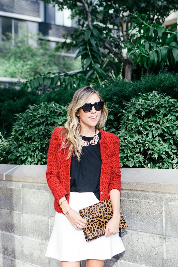 white fluted skirt and red blazer