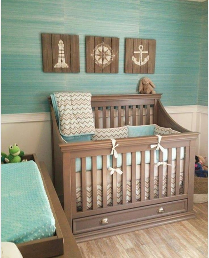 Ocean themed nursery add some soft pink and white maybe s chevron and I  think it's perfect!