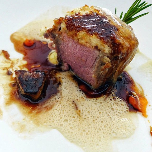 Roast veal fillet, celery root purée, caramelized onions on top.