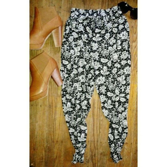 B & W Parachute Pant Black and white parachute pants with elastic waist. Stretch material with side pockets. Pants