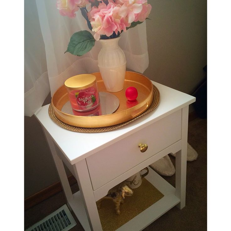 White & gold bed side table from ikea. Gold plate from target. Flowers from Michaels.