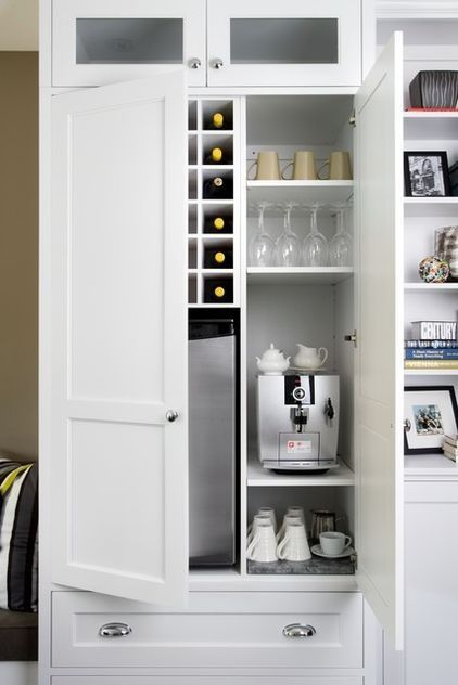 beverage station: coffeemaker, mugs and teacups, mini fridge for bottled drinks