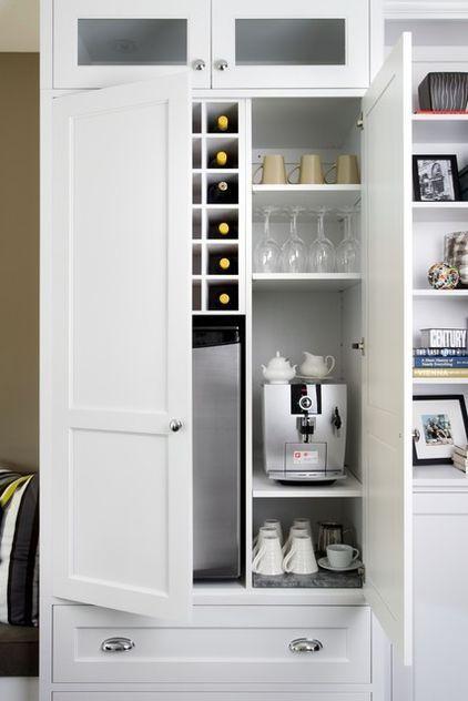 beverage station: coffeemaker, mugs and teacups, mini fridge for bottled drinks