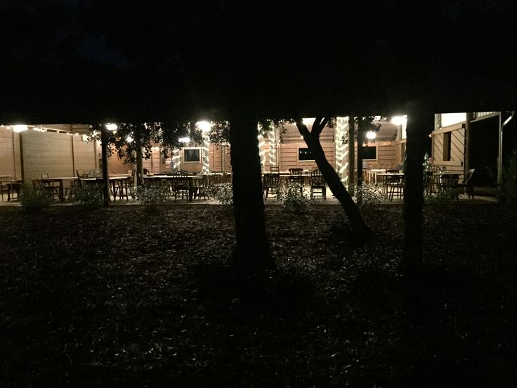 A view from garden looking in to Cielo Blu Barn at night.