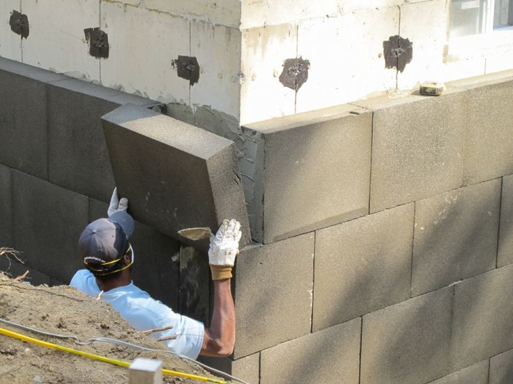 We installed 6-inch Foamglas blocks on the exterior foundation walls using a polymer-cement adhesive.