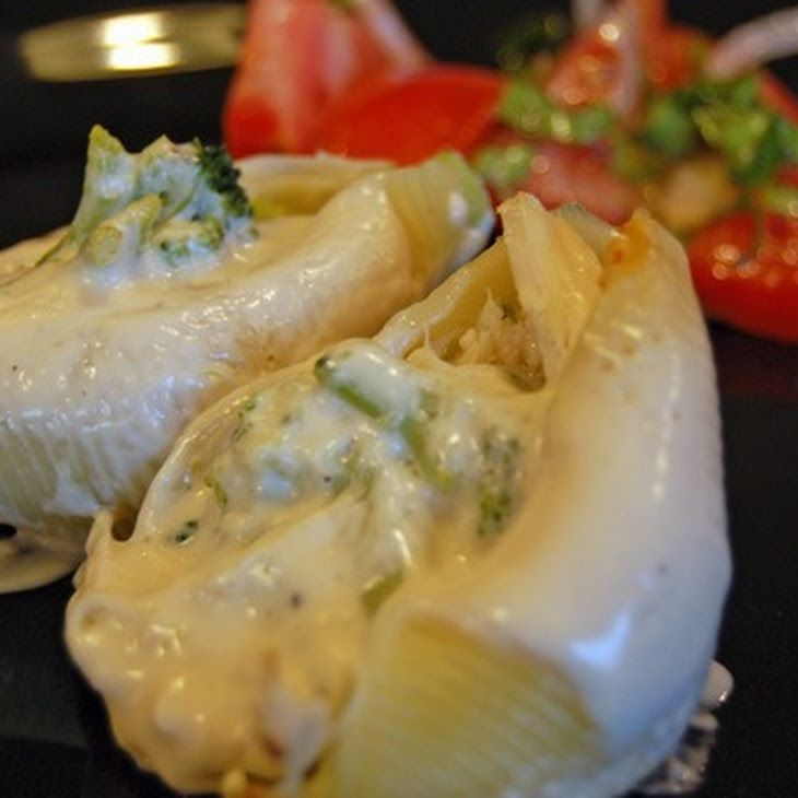 Chicken and Broccoli Stuffed Shells with Alfredo Sauce Recipe. Made with one jar sauce, one bag broccoli, two shredded chicken breast. A bit of Italian seasoning.  Super easy, and a complete meal as is. Maybe replace chicken with crab.